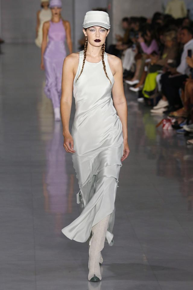 <p>Gigi also wore a slinky silver dress and matching cap on the Max Mara runway.</p>
