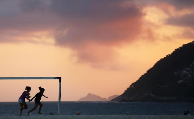 RIO DE JANEIRO, BRAZIL - OCTOBER 26: Girls play soccer on Ipanema Beach on October 26, 2013 in Rio de Janeiro, Brazil. Brazil is gearing up to host the 2014 FIFA World Cup and Rio 2016 Olympic Games. (Photo by Mario Tama/Getty Images)