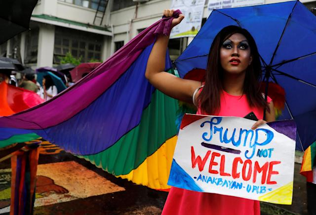<p>A member of a group supporting LGBT rights displays a placard during a protest ahead of U.S. President Donald Trump's visit, at the University of the Philippines in Los Banos, Laguna, Philippines, Nov. 9, 2017. (Photo: Erik De Castro/Reuters) </p>