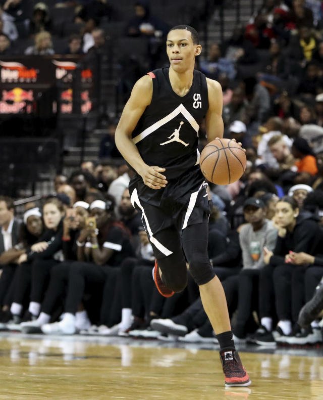 FILE - In this April 8, 2018, file photo, the Black Team's Darius Bazley (55) moves the ball against the White Team during the Jordan Brand Classic high school basketball game, in New York. Bazley skipped playing in college at Syracuse and has spent months training for the NBA draft. (AP Photo/Gregory Payan, File)