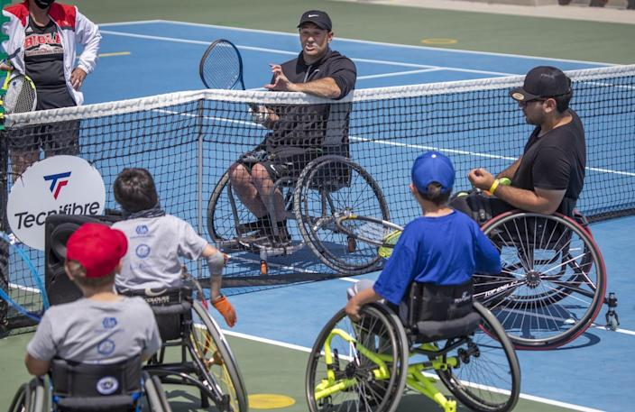 Paralympian David Wagner speaks with youth players April 24 at Orange County Great Park in Irvine.
