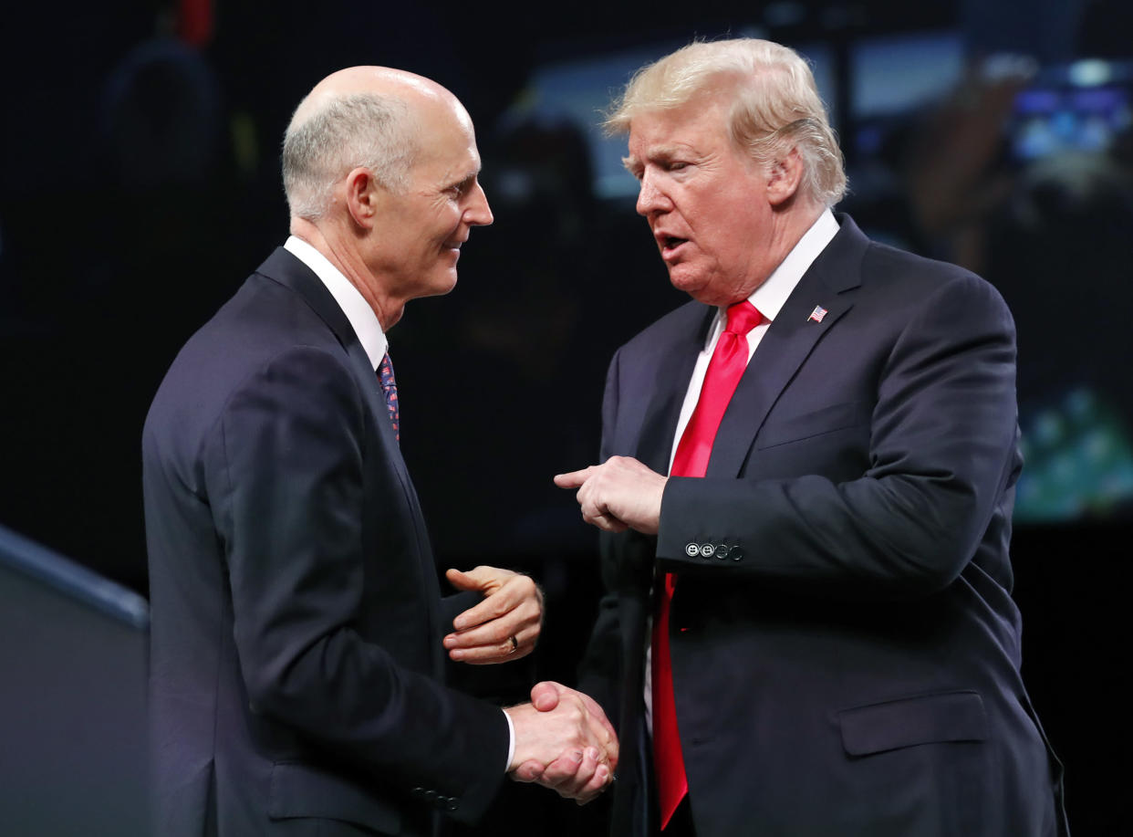 Gov. Rick Scott, R-Fla., left, speaks with President Trump as he arrives to speak at the International Association of Chiefs of Police annual conference on Oct. 8, 2018, in Orlando, Fla. (Photo: Alex Brandon/AP)