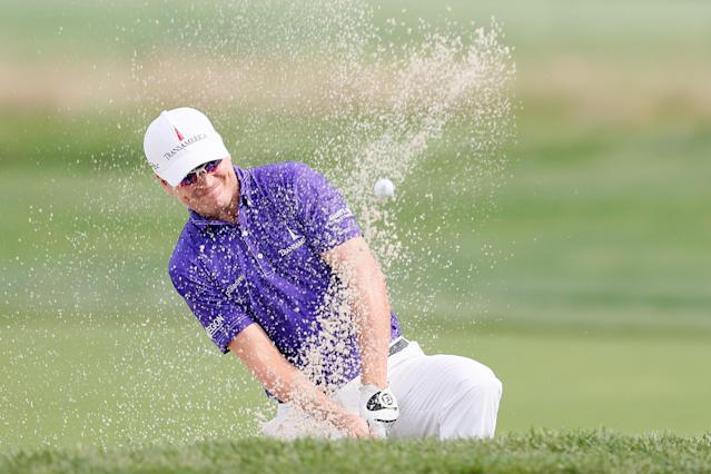 FARMINGDALE, NY - AUGUST 23: Zach Johnson hits a shot out of the bunker on the 16th hole during the First Round of The Barclays on the Black Course at Bethpage State Park August 23, 2012 in Farmingdale, New York. (Photo by Kevin C. Cox/Getty Images)