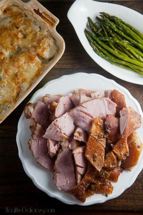 "<p>Ham is an Easter classic, but sometimes the sugar level in the glaze can be a bit too high for our bodies' liking. We found a healthier version combining grainy dijon mustard, <a rel=""nofollow"" href=""http://www.drozthegoodlife.com/healthy-food-nutrition/nutrition/a1891/health-benefits-apple-cider-vinegar/"">apple cider vinegar</a>, and apricot preserves. Just make sure to buy sugar-free apricot preserves, or even better, make your own. </p><p>Get the recipe at <a rel=""nofollow"" href=""http://www.healthy-delicious.com/apricot-mustard-baked-ham-for-sundaysupper/"">Healthy Delicious</a>. </p>"