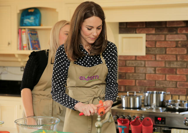 The Duchess of Cambridge prepares soup with members and staff in the kitchen area. (Press Association)