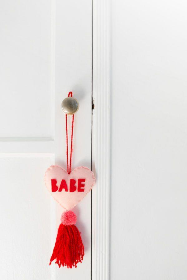 """<p>When it comes to romance, it's all about the first impression! Give your guests something to talk about as soon as they walk in the door with this sweet craft.</p><p><strong>Get the tutorial at <a href=""""https://studiodiy.com/2018/02/06/diy-conversation-heart-tassel-charms/"""" rel=""""nofollow noopener"""" target=""""_blank"""" data-ylk=""""slk:Studio DIY"""" class=""""link rapid-noclick-resp"""">Studio DIY</a>.</strong></p><p><a class=""""link rapid-noclick-resp"""" href=""""https://www.amazon.com/Lion-Brand-Yarn-215-113-Feels/dp/B079P9VJMK?tag=syn-yahoo-20&ascsubtag=%5Bartid%7C10050.g.2971%5Bsrc%7Cyahoo-us"""" rel=""""nofollow noopener"""" target=""""_blank"""" data-ylk=""""slk:SHOP YARN"""">SHOP YARN</a></p>"""