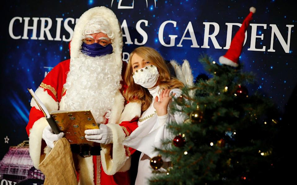 Masked santas could become a feature of Christmas this year -  FABRIZIO BENSCH/Reuters
