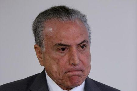 Brazil's President Michel Temer reacts during a ceremony at the Planalto Palace in Brasilia, Brazil April 12, 2017. REUTERS/Ueslei Marcelino