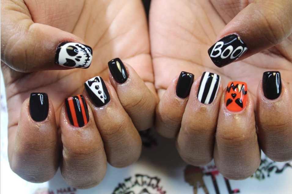 """<p><a href=""""https://www.instagram.com/p/B4M8TPYBQI4/"""" rel=""""nofollow noopener"""" target=""""_blank"""" data-ylk=""""slk:Nail artist Tahra"""" class=""""link rapid-noclick-resp"""">Nail artist Tahra</a> incorporates the word """"Boo!"""" in her black and orange nails for a classic Halloween vibe. But even if you don't have great penmanship, there are nail stickers to help you achieve the same look.</p><p><a class=""""link rapid-noclick-resp"""" href=""""https://go.redirectingat.com?id=74968X1596630&url=https%3A%2F%2Fwww.etsy.com%2Flisting%2F723366002%2Fscarey-halloween-nail-art-3d-glitter&sref=https%3A%2F%2Fwww.oprahdaily.com%2Fbeauty%2Fskin-makeup%2Fg33239588%2Fhalloween-nail-ideas%2F"""" rel=""""nofollow noopener"""" target=""""_blank"""" data-ylk=""""slk:SHOP NAIL STICKERS"""">SHOP NAIL STICKERS</a></p>"""