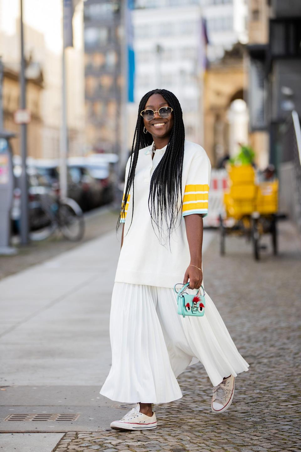 <p>I love this look because it's so playful and casual. Oversize skirts and tees pair really well together in the same colors. Pro tip: add a bright mini bag and shades to balance a casual Converse sneaker.</p>