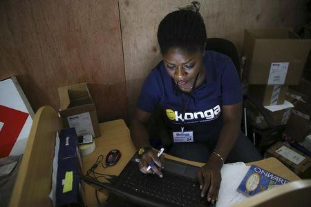 A staff inputs data into a computer at the warehouse of Konga online shopping company in Ilupeju district in Nigeria's commercial capital Lagos