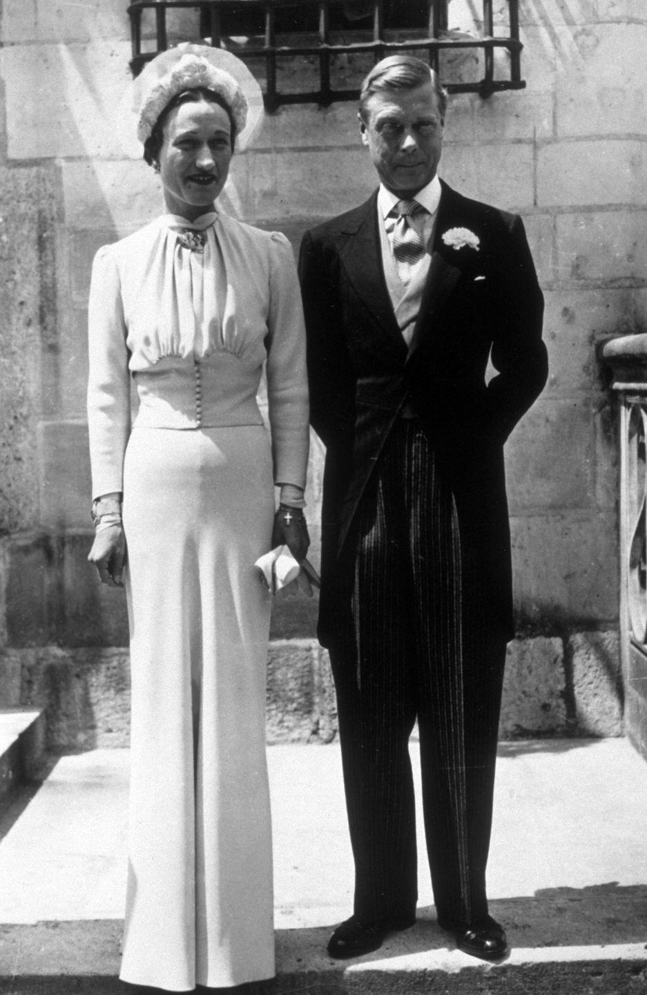 <p>Wallis Simpson was an American socialite who intended to marry the British King Edward VIII. Because of her non-royal status and first marriage that ended in divorce, the king was forced to abdicate his throne in order to marry her. Wallis wore a subtle, blue dress to their wedding, which none of Edward's family attended.</p>