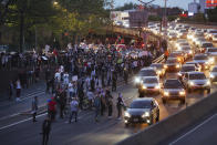 Activists supporting Palestine block traffic on Interstate 278 Saturday, May 15, 2021, in New York. The rally supports Palestine in the ongoing conflict between Israel and Palestine on the day Israeli airstrikes leveled several buildings in the Gaza strip. (AP Photo/Kevin Hagen)