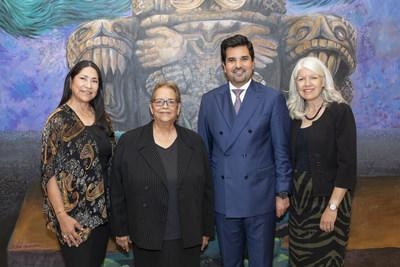 Standing at a mural inside the Multicultural Education and Counseling through the ARTs (MECA) community center are (L to R): Graciela Saenz, Attorney and Qatar Harvey Fund Advisory Board Member; Alice Valdez, Founder and Executive Director of MECA; H. E. Sheikh Meshal bin Hamad Al-Thani, Qatar's Ambassador to the U.S.; and Karla Cisneros, Houston City Council Member.