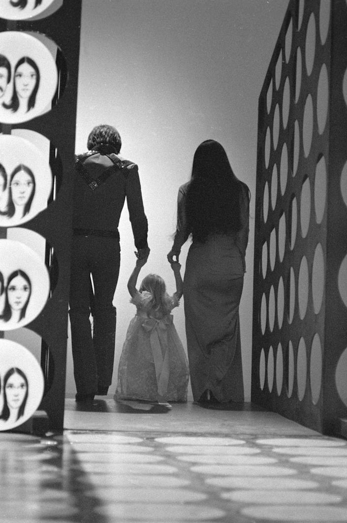 <p>The daughter of Sonny and Cher Bono, who now identifies as Chaz Bono, visited the set of <em>The Sonny & Cher </em><em>Comedy Hour</em> in 1971. Here, they all walk off the stage at the end of an episode holding hands. Face it: Not many kids get to be on TV. </p>