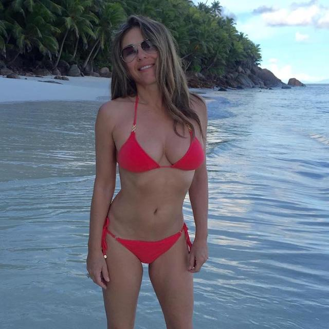 "<p>Tropical island views behind her, sunkissed hair wafting into her face… it's no wonder the actress planted a kiss for a caption on this enviable pic. (Photo: <a href=""https://www.instagram.com/p/BS1gHraAjb7/?taken-by=elizabethhurley1"" rel=""nofollow noopener"" target=""_blank"" data-ylk=""slk:Elizabeth Hurley via Instagram"" class=""link rapid-noclick-resp"">Elizabeth Hurley via Instagram</a>) </p>"