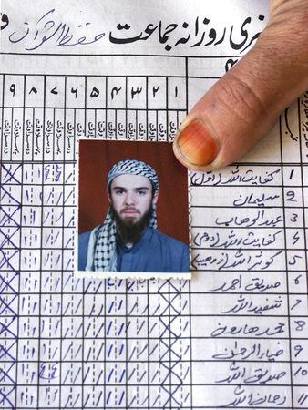 FILE PHOTO: A picture of John Walker Lindh is shown on the attendance register of the madrassa (Islamic school) Arabia Hassani Kalan Surani Bannu, in Bannu in Pakistan, January 26, 2002. REUTERS/Haider Shah/File Photo