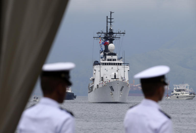 The second warship of the Philippine Navy, the BRP Ramon Alcaraz prepares to dock for a formal welcoming ceremony Tuesday, Aug. 6, 2013 at Subic Freeport, about 80 kilometers (50 miles) northwest of Manila, Philippines. The Philippines on Tuesday celebrated the arrival of the decommissioned U.S. Coast Guard cutter as its second major warship to challenge China's massive territorial claims that Filipino officials say have intruded into their country's potentially oil-rich offshore seas. (AP Photo/Bullit Marquez)
