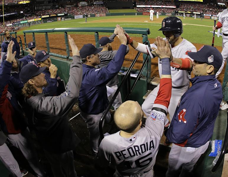 Boston Red Sox's Shane Victorino is greeted after scoring during the sixth inning of Game 3 of baseball's World Series against the St. Louis Cardinals Saturday, Oct. 26, 2013, in St. Louis. (AP Photo/Matt Slocum)