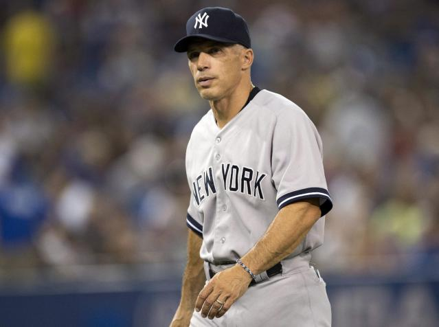 FILE - In this Aug. 28, 2013, file photo, New York Yankees manager Joe Girardi walks off the field during a baseball game against the Toronto Blue Jays in Toronto. Girardi signed a four-year contract extension to stay with the New York Yankees, Wednesday, Oct. 9, 2013. (AP Photo/The Canadian Press, Frank Gunn, File)