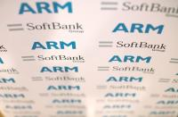 FILE PHOTO: An ARM and SoftBank Group branded board is displayed at a news conference in London