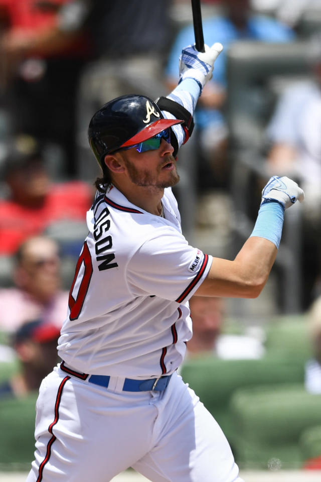 Atlanta Braves' Josh Donaldson watches his two-run home run during the third inning of a baseball game against the Philadelphia Phillies, Sunday, June 16, 2019, in Atlanta. (AP Photo/John Amis)