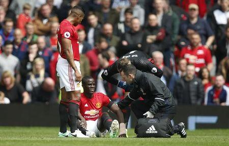 Britain Football Soccer - Manchester United v Swansea City - Premier League - Old Trafford - 30/4/17 Manchester United's Eric Bailly receives medical attention after sustaining an injury  Reuters / Andrew Yates Livepic