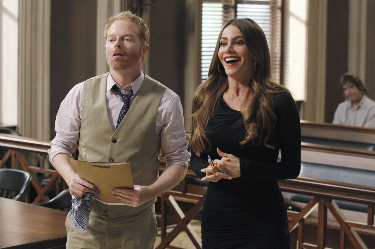 "This publicity image released by ABC shows Jesse Tyler Ferguson, left, and Sofia Vergara in a scene from ""Modern Family."" Vergara is nominated for best supporting actress in a comedy series for her role as Gloria Pritchett. The Academy of Television Arts & Sciences' Emmy ceremony will be hosted by Neil Patrick Harris. It will air Sept. 22 on CBS. (AP Photo/ABC, Peter ""Hopper"" Stone)"