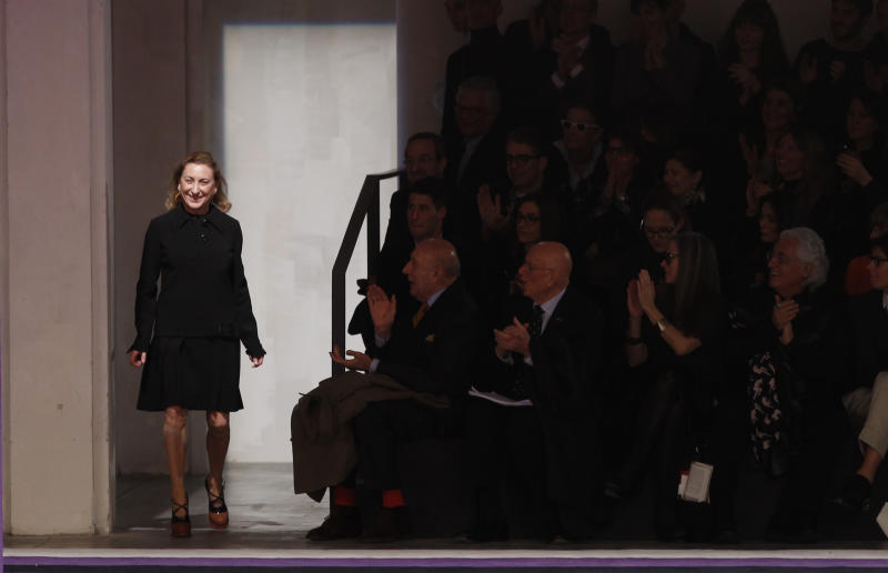 Italian fashion designer Miuccia Prada acknowledges applause at the end of the presentation of Prada women's Fall-Winter 2012-2013 collection in Milan, Italy, Thursday, Feb. 23, 2012. (AP Photo/Luca Bruno)