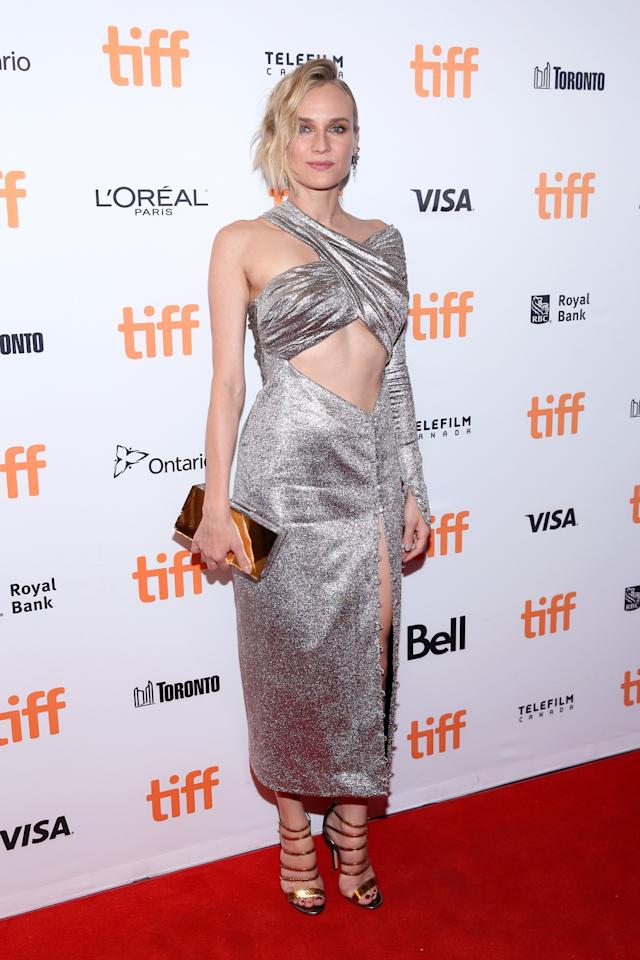 """<p>The fashion-forward starlet left little to the imagination on the red carpet for """"In the Fade"""" on Tuesday, Sept. 12. She wore a pewter-hued dress with a thigh-high slit and strategically-placed cutout detailing that showed off her washboard abs. </p>"""