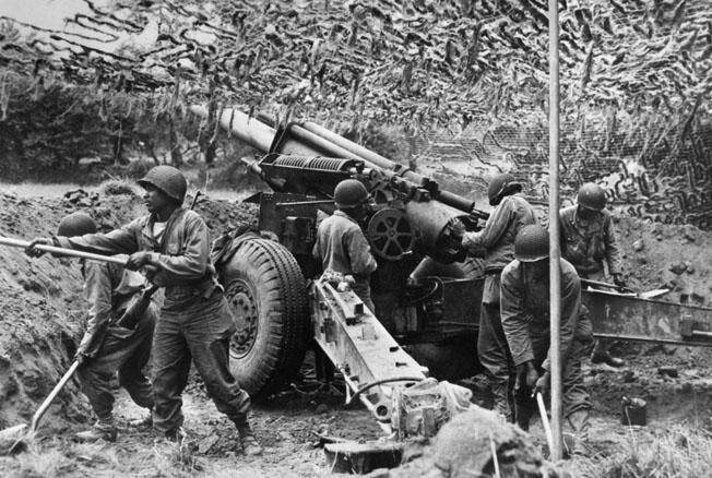 Men of the 333rd emplace one of their 155mm howitzers in a Normandy field, June 28, 1944. The battalion soon proved its worth in battle and their services were in high demand by white infantry units.