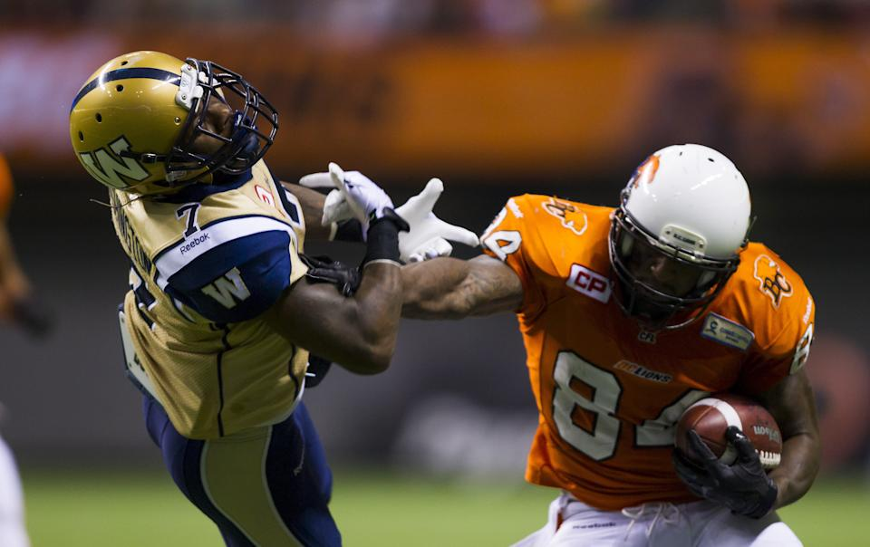 B.C Lions wide receiver Manny Arceneaux (84) straight arms Winnipeg Blue Bombers defensive back Demond Washington (7)  during the first half of their CFL football game in Vancouver, British Columbia, October 10, 2015. REUTERS/Ben Nelms