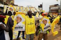 A polling agent from the National Resistance Movement (NRM) party celebrates the victory of Uganda's President Yoweri Museveni in the concluded general elections in Kampala