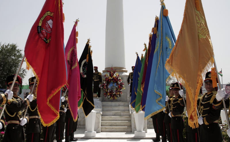 Members of the Honor Guard stand at attention during Independence Day celebrations at a Defense minister office in Kabul, Afghanistan, Monday, Aug 19, 2013. Afghan officials' mark the country's 94th independence day from Britain with a small military parade and folk festivals in the capital. (AP Photo/Rahmat Gul)