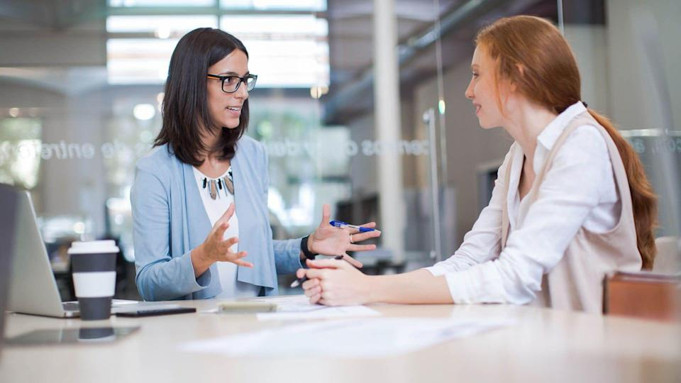 Coaching, two business women working together