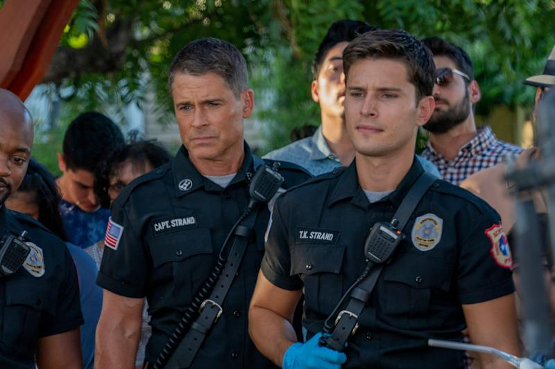 Owen Strand (Rob Lowe), left, and his son, T.K. (Ronen Rubenstein), are firefighters who move from New York to Austin, Texas, in the Fox drama series, '9-1-1: Lone Star.'