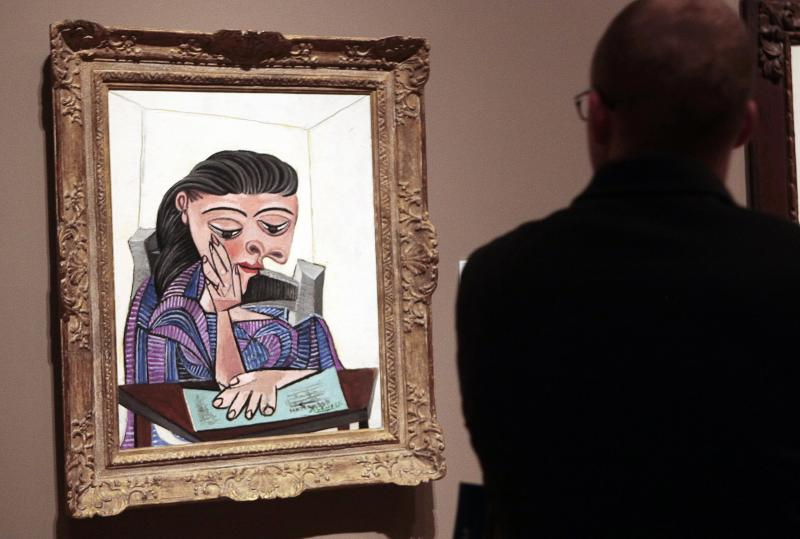 A visitor stops to look at a painting by Picasso at the Detroit Institute of Arts in Detroit in this file photo