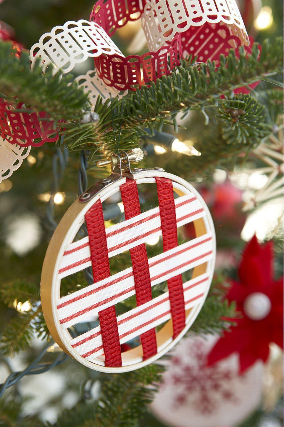 """<p>So you own a hoop, but aren't into embroidery? Good thing the circular shape is just begging to be made into an ornament. After weaving <a href=""""https://www.amazon.com/Christmas-Grosgrain-Multicolor-Metallic-Glitter-Ribbons/dp/B07J1QBQW9?tag=syn-yahoo-20&ascsubtag=%5Bartid%7C10055.g.2996%5Bsrc%7Cyahoo-us"""" rel=""""nofollow noopener"""" target=""""_blank"""" data-ylk=""""slk:ribbon"""" class=""""link rapid-noclick-resp"""">ribbon</a> inside the circle and adding a hook on top, this hoop is ready to hang front and center on your tree. </p><p><em><a href=""""https://www.goodhousekeeping.com/holidays/christmas-ideas/g469/scandinavian-christmas-decorations/?slide=9"""" rel=""""nofollow noopener"""" target=""""_blank"""" data-ylk=""""slk:Get the tutorial »"""" class=""""link rapid-noclick-resp"""">Get the tutorial »</a></em></p>"""