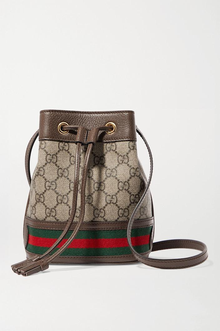 """<p><strong>Gucci</strong></p><p>net-a-porter.com</p><p><strong>$1250.00</strong></p><p><a href=""""https://go.redirectingat.com?id=74968X1596630&url=https%3A%2F%2Fwww.net-a-porter.com%2Fen-us%2Fshop%2Fproduct%2Fgucci%2Fophidia-mini-textured-leather-trimmed-printed-coated-canvas-bucket-bag%2F1294492&sref=https%3A%2F%2Fwww.harpersbazaar.com%2Ffashion%2Ftrends%2Fg4447%2Fluxury-gifts-for-women%2F"""" rel=""""nofollow noopener"""" target=""""_blank"""" data-ylk=""""slk:Shop Now"""" class=""""link rapid-noclick-resp"""">Shop Now</a></p><p>A classic.</p>"""