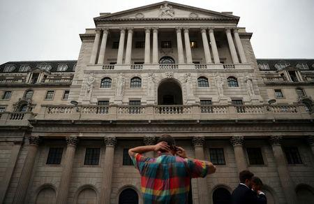 A man speaks on his phone outside the Bank of England in the City of London, Britain, August 23, 2017. REUTERS/Hannah McKay