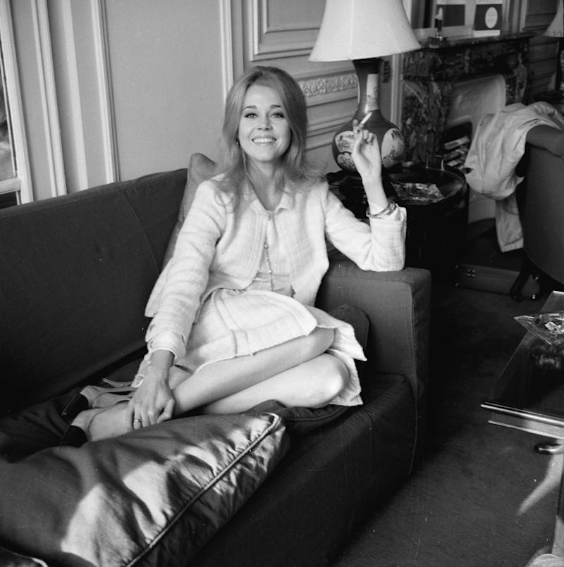 Fonda on a sofa at the Savoy Hotel in London.