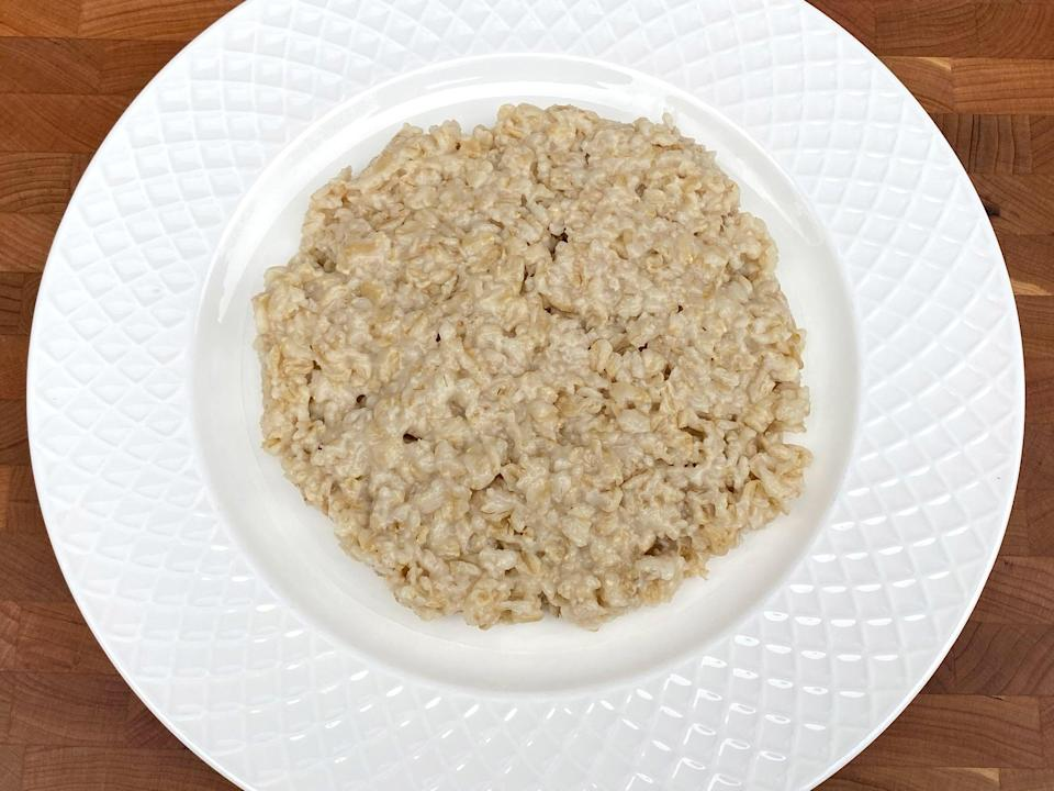 <p>2/3 cup of uncooked rolled oats or 1 1/2 cups of cooked rolled oats (cooked in water)</p>