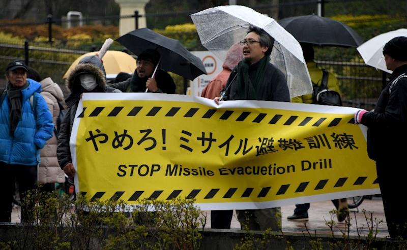 There were also demonstrations held against the drill (AFP Photo/Toshifumi KITAMURA)