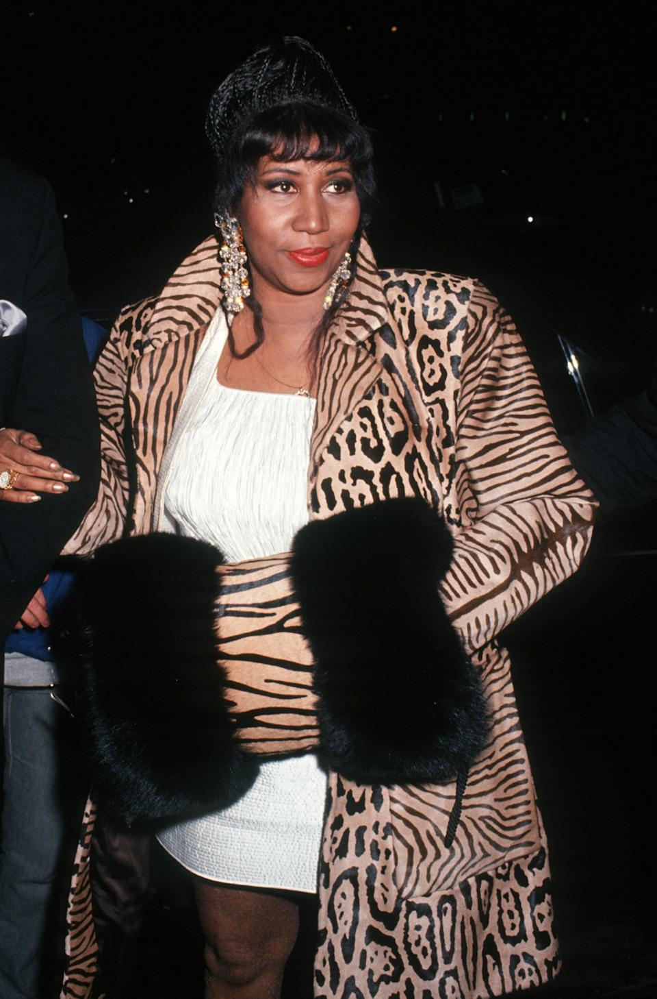 <p>Aretha Franklin wears a white mini dress underneath a leopard print coat with black fur trimmings and statement crystal earrings at the Arista Records Pre-Grammy Party. (Photo by Ron Galella, Ltd./WireImage) </p>