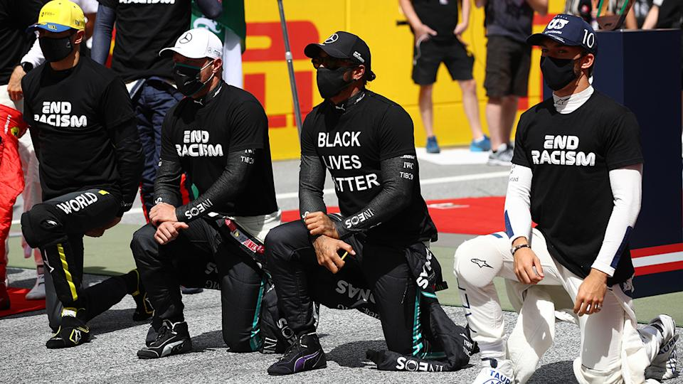 Lewis Hamilton and other F1 drivers are pictured taking a knee prior to the Styrian Grand Prix.