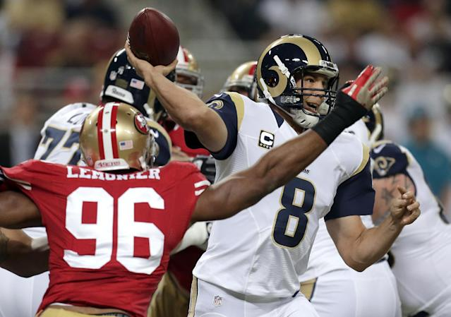 St. Louis Rams quarterback Sam Bradford (8) throws under pressure form San Francisco 49ers linebacker Corey Lemonier (96) during the first quarter of an NFL football game Thursday, Sept. 26, 2013, in St. Louis. (AP Photo/Charlie Riedel)