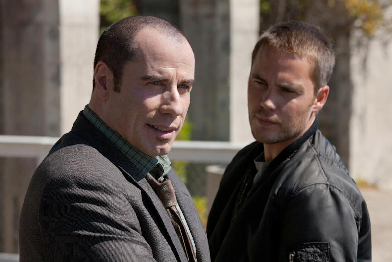 """This film image released by Universal Pictures shows John Travolta , left, and Taylor Kitsch in a scene from """"Savages."""" (AP Photo/Universal Pictures, Francois Duhamel)"""