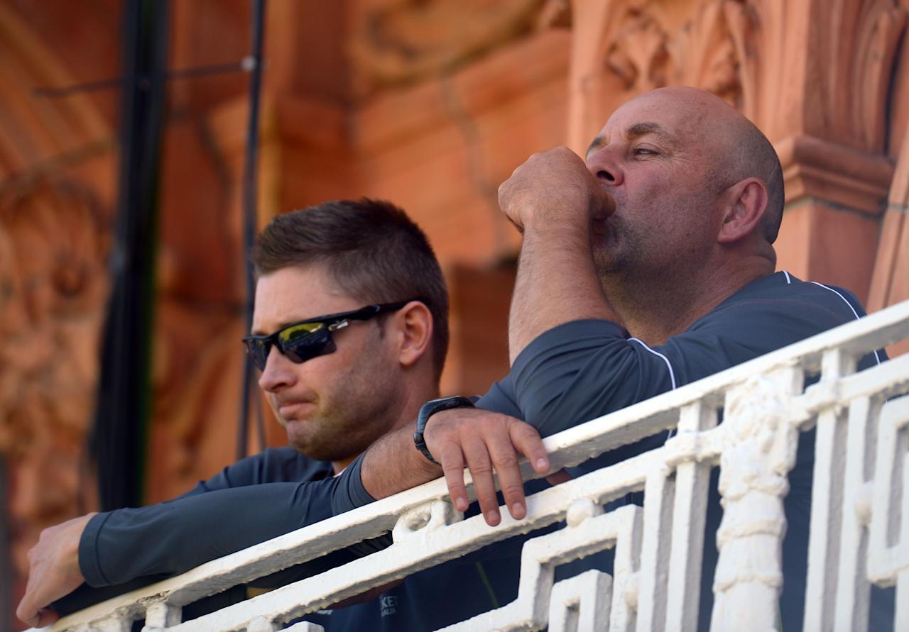 Australia's coach Darren Lehmann (right) and captain Michael Clarke sit on the balcony on day two of the Second Investec Ashes Test at Lord's Cricket Ground, London.