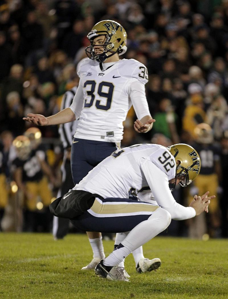 Pittsburgh kicker Kevin Harper (39) and holder Matt Yoklic react after Harper missed what would have been the game-winning field goal in the second overtime period against Notre Dame in an NCAA college football game in South Bend, Ind., Saturday, Nov. 3, 2012. Notre Dame defeated Pittsburgh 29-26 in triple overtime.  (AP Photo/Michael Conroy)