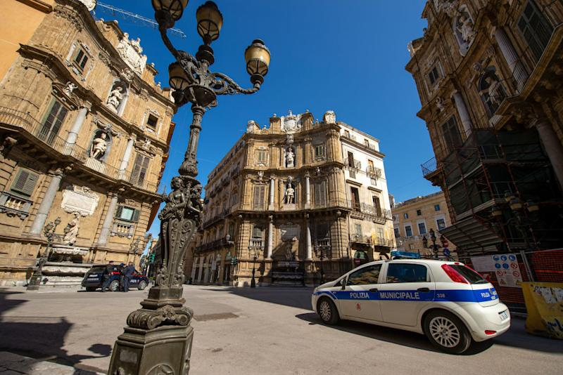 A police car is shown driving on the streets of Palermo, Italy as the coronavirus lockdown continues.